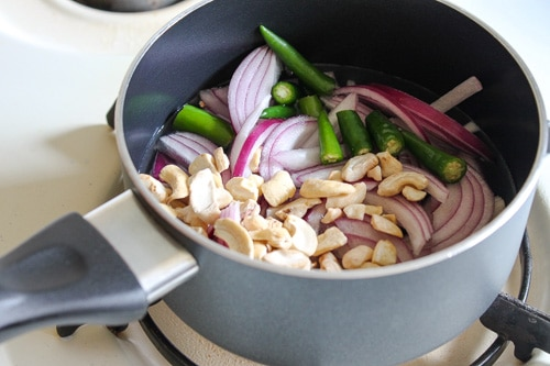 cooking onion, cashews and green chilies