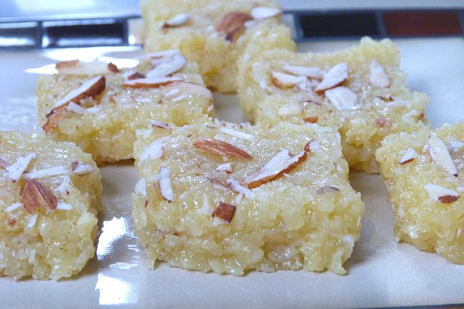 Kopra pak recipe - This Gujarati style of making coconut burfi. This sweet or mithai is made from freshly grated coconut, sugar, milk and mawa.