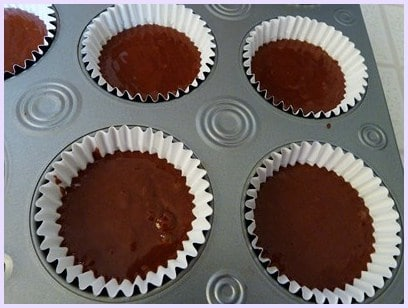 Eggless chocolate cupcakes batter in muffin tray