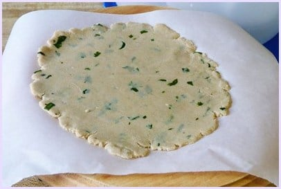 rolled paratha on parchment paper
