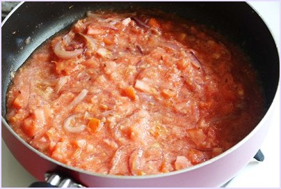 adding chopped tomatoes and pureed tomatoes
