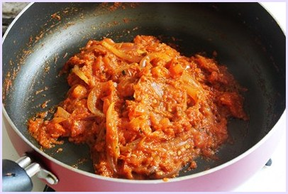 tomatoes are cooked till thick paste