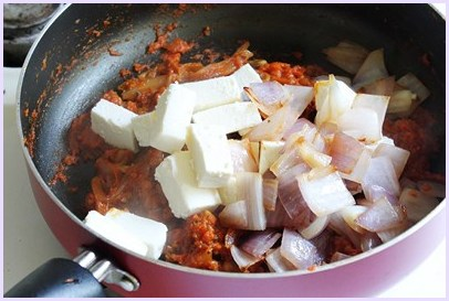adding paneer and cooked onion cubes
