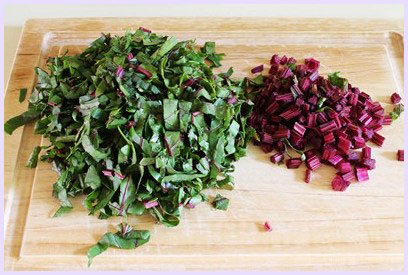 Chopping beetroot leaves