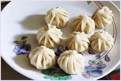 all shaped modaks on a plate