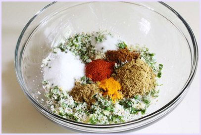 adding spice powders to stuffing mixture