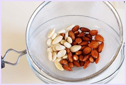 peeling the blanched almonds