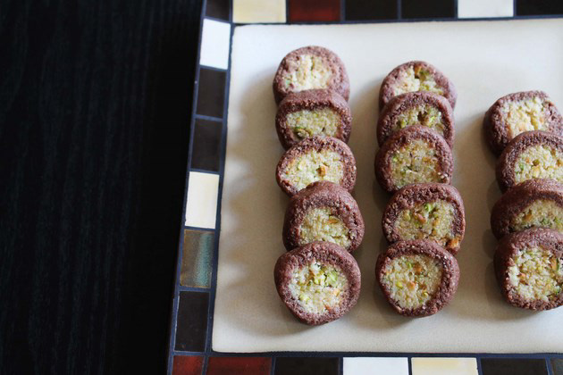 Chocolate pista rolls arranged on a plate