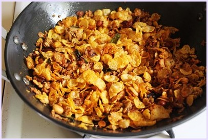 mixing cereal into spice mixture