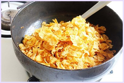 adding corn flakes cereal