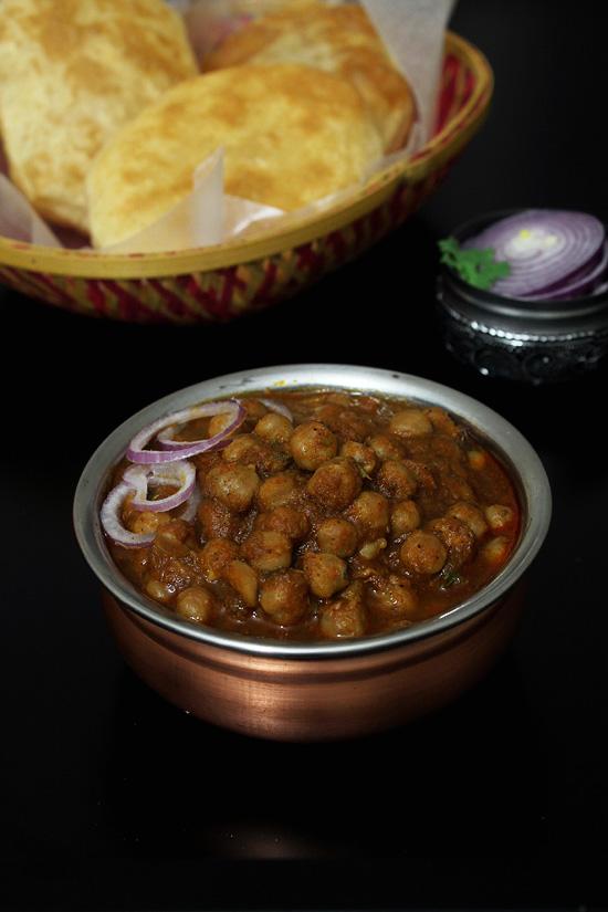Chole recipe or chana masala recipe - boiled chickpeas are simmered in punjabi onion tomato gravy. because it is made in a pressure cooker, it is very easy to make. alternately you can use electric pressure cooker - Instant pot. When served with bhature, kulche, naan or paratha, it makes the filling dinner. Check out the recipe where I shared step by step photos.  #punjabifood #indianrecipe #dinner
