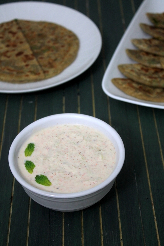 Cucumber raita is a simple, perfect side dish for biryani, pulao or paratha. This is Indian yogurt based side dish where grated cucumber, mint leaves and few spices are mixed with plain yogurt. You can use greek yogurt too. and to make it vegan, please use vegan yogurts like cashew yogurt or soy yogurt. #indianfood #raita