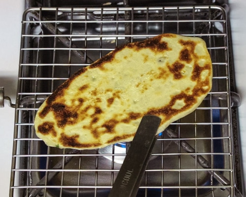 roasting the naan on direct flame