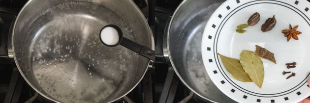 boiling water with salt, spices to cook rice for paneer biryani