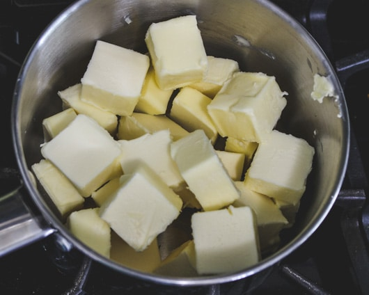 chunks of unsalted butter in a pan