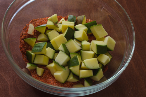 raw mango pieces are added to the spice mixture