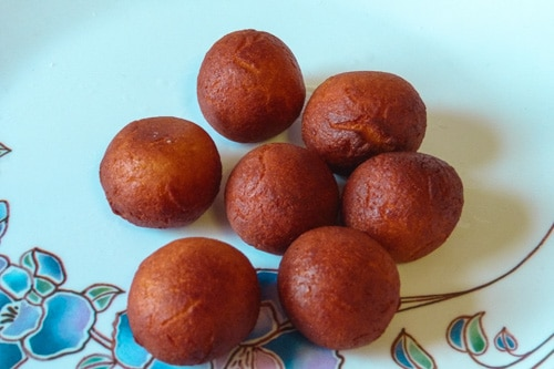 fried khoya balls are cooling in a plate