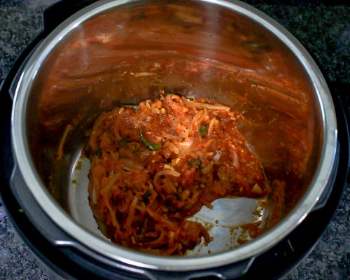 spice powders mixed with cooked tomatoes
