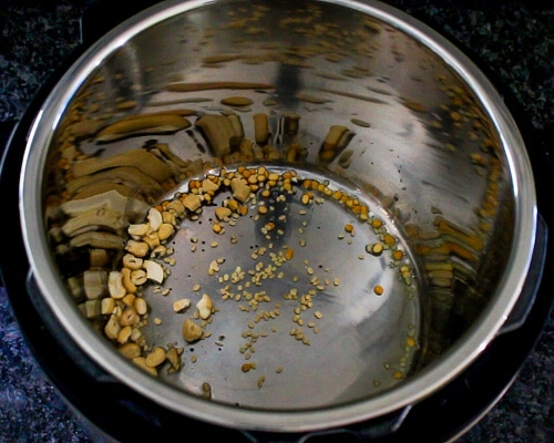 tempering mustard seeds, dal and cashews