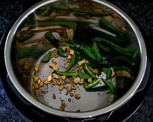 adding green chilies and curry leaves
