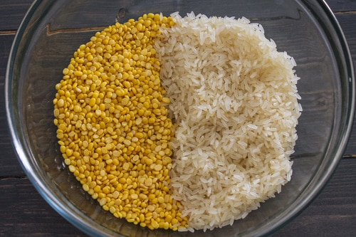 yellow moong dal and rice in a bowl for khichdi