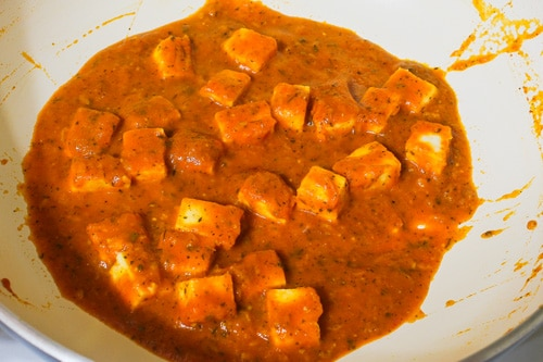 mixing paneer and simmering gravy