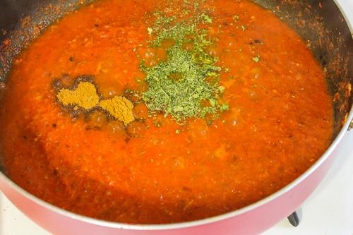 adding garam masala and kasoori methi to gravy