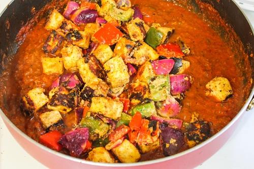 adding paneer tikka to the gravy