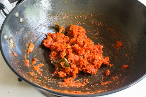 freshly ground masala mixed with cooked tomatoes