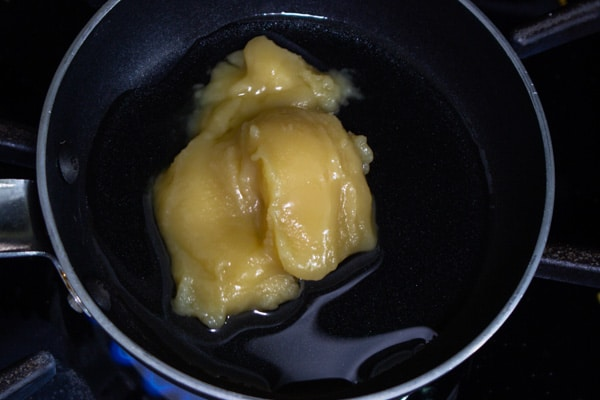 mixture of ghee and oil in a small pan