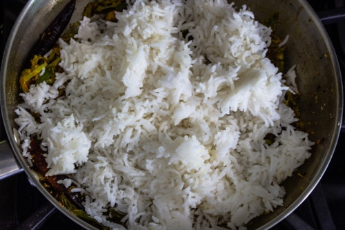 adding cooked rice