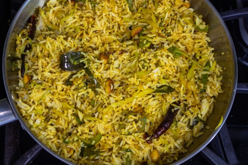 rice is mixed with spiced cabbage mixture