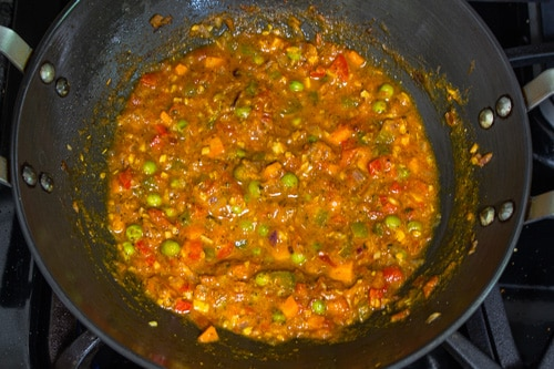 adding water to make masala pasta sauce