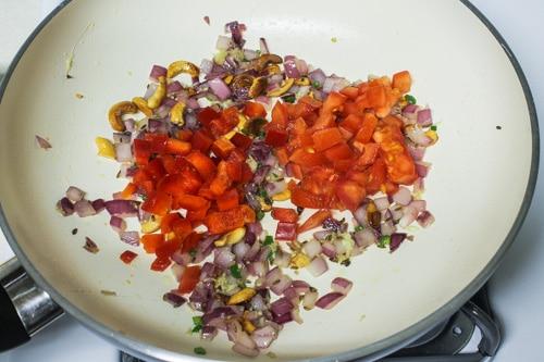 adding tomato and capsicum