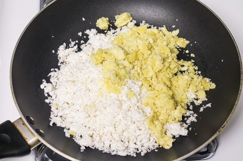 grated coconut and jaggery in a pan