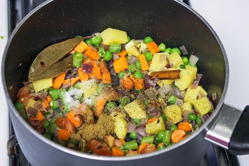 adding salt, pepper and garam masala