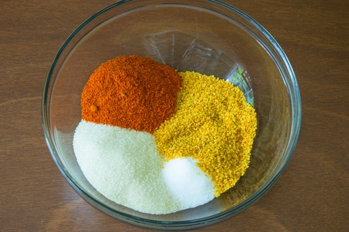 rai kuria, red chili powder, salt and sugar in a bowl