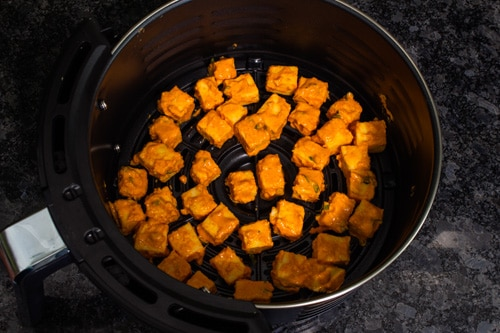 batter coated paneer in air fryer basket