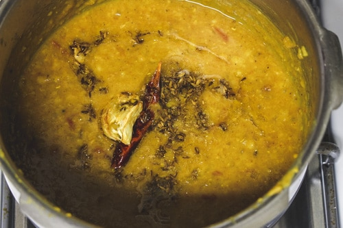 adding tempering to the dal tadka