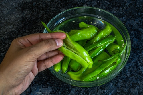 chili peppers in salted water