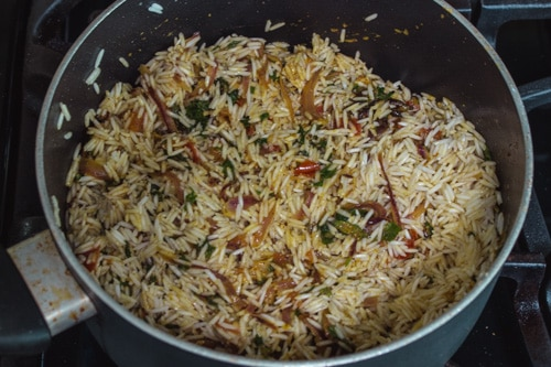adding soaked basmati rice