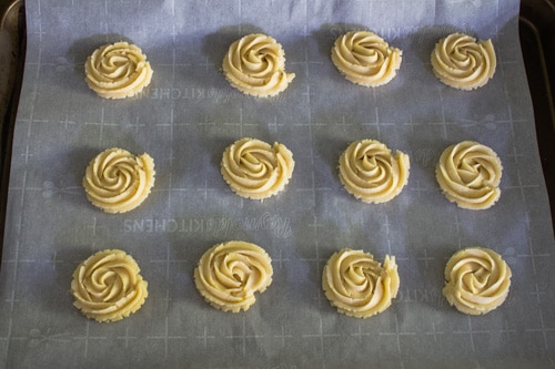 piped cookies on baking tray