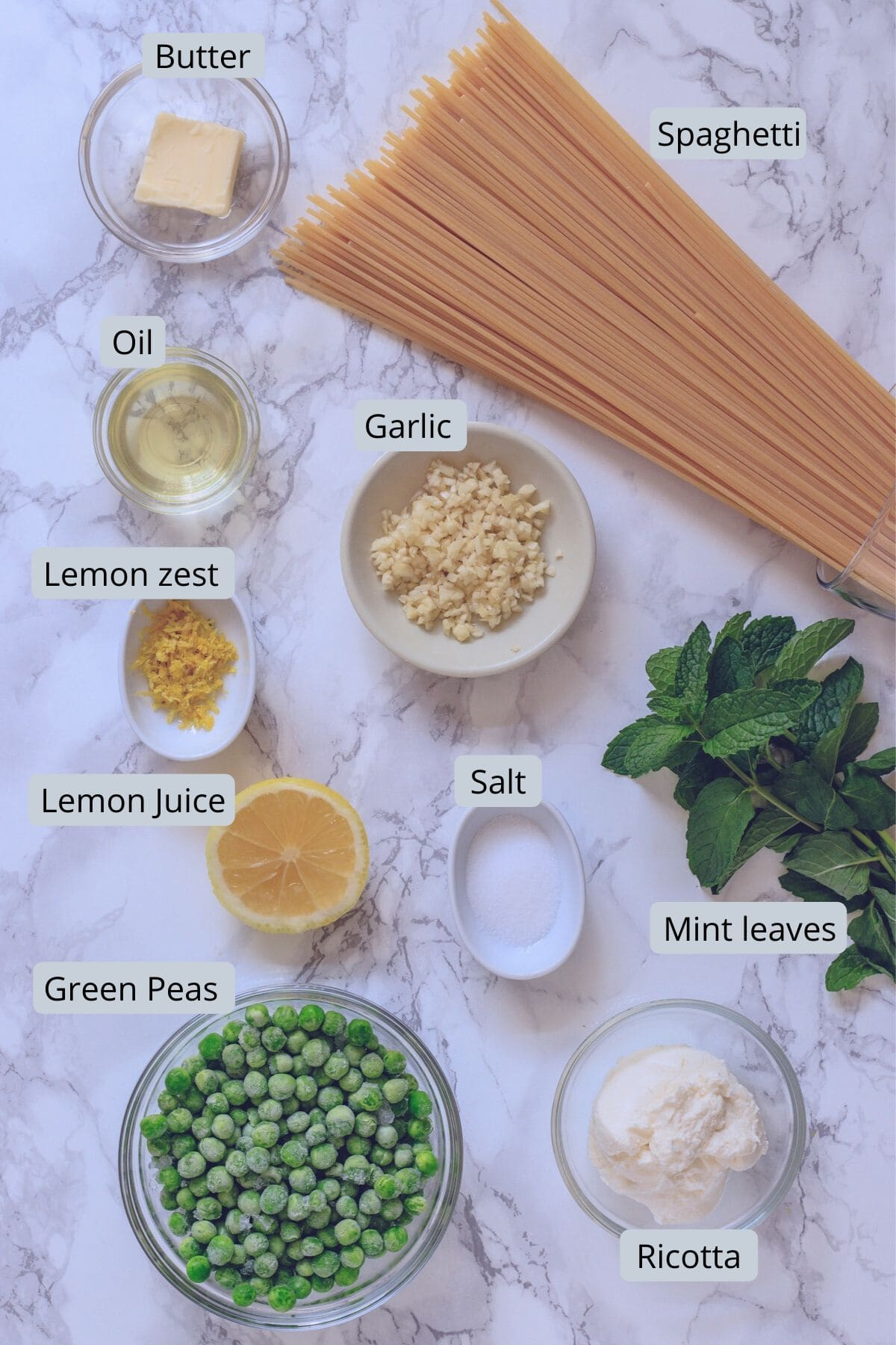 ingredients in individual bowls for peas, ricotta pasta