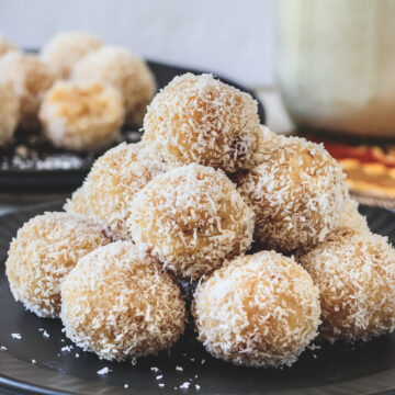 stack of coconut ladoos on the plate