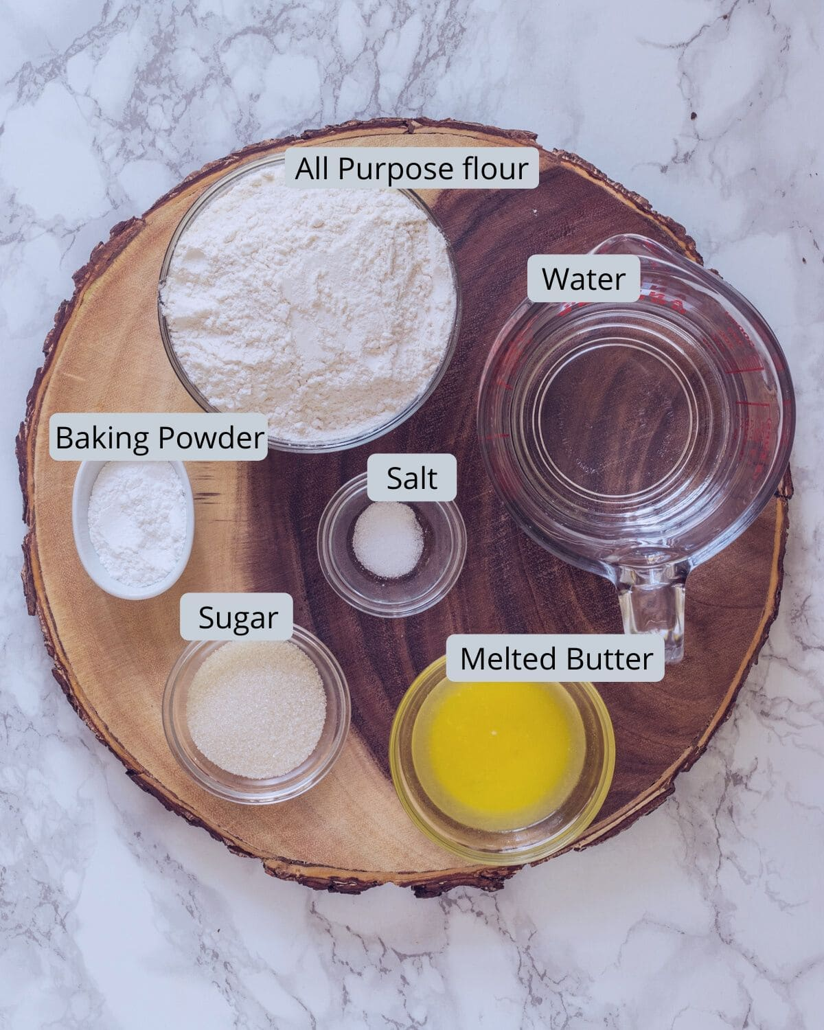 eggless pancake ingredients in individual bowls on a wooden board