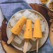 3 Mango Kulfi on ice cubes full of plate & napkin under it
