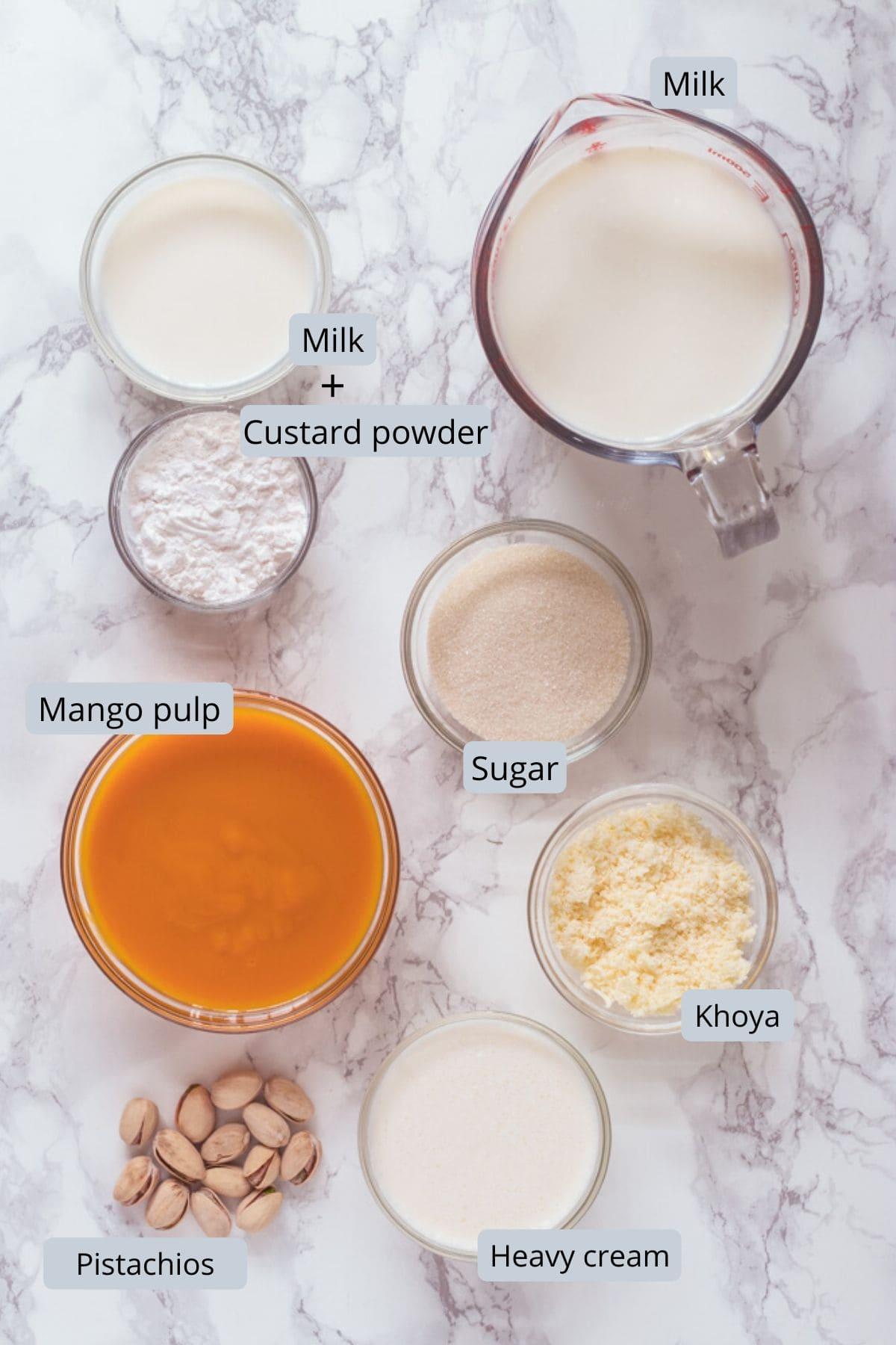 mango kulfi ingredients in individual bowls
