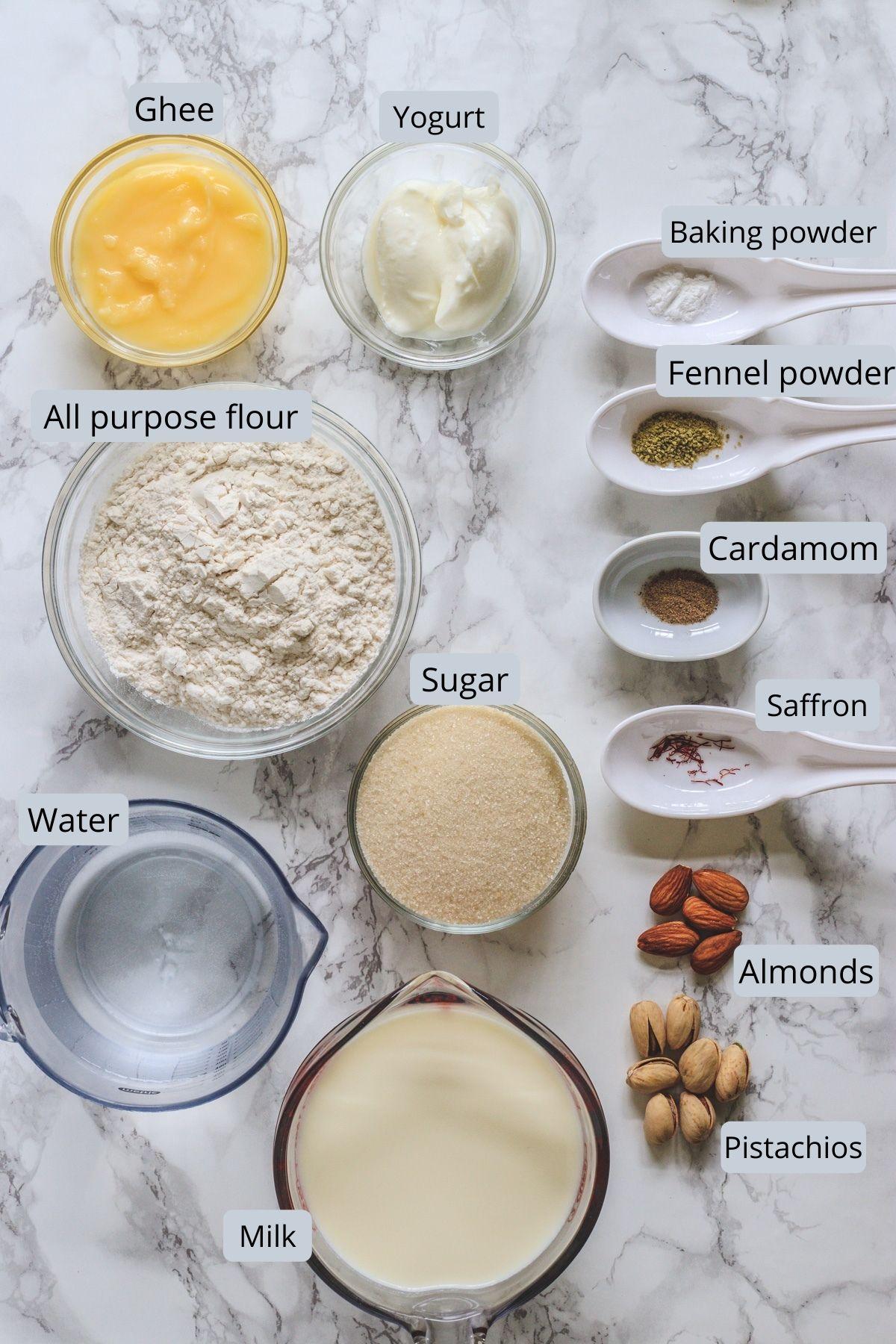 ingredients used in malpua inclides flour, cardamom, fennel powder, baking powder, water, sgar, yogurt, ghee, milk, nuts.