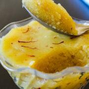 Badam halwa take with a spoon ready to eat