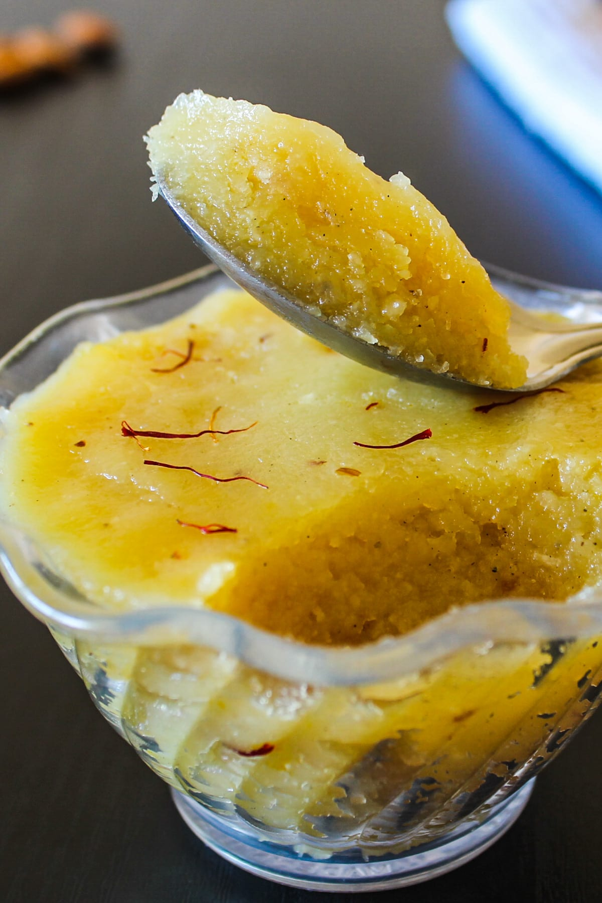 Badam halwa take with a spoon ready to eat
